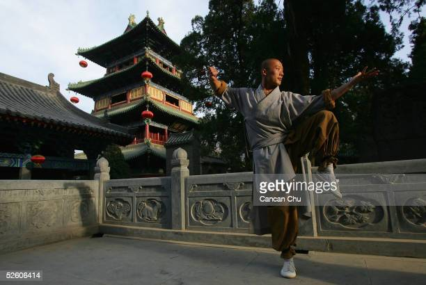 A warrior monk of Shaolin Temple displays his Kung Fu skills outside of the temple April 6 2005 in Dengfeng Henan Province China Shaolin Temple built...