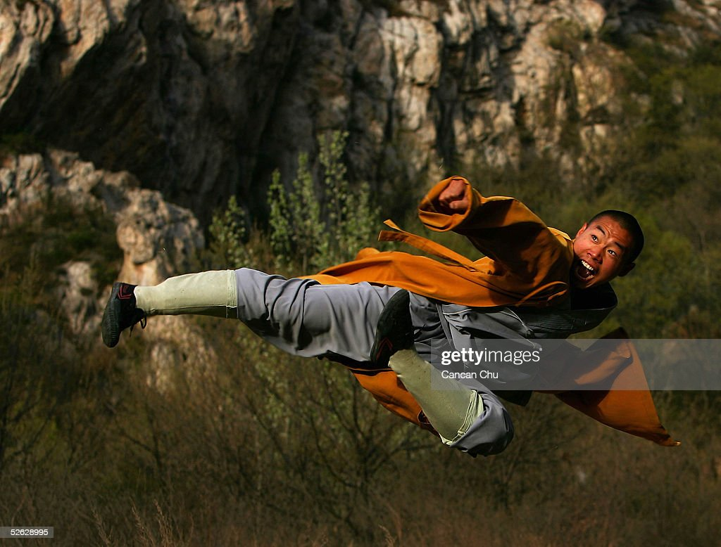 A warrior monk of the Shaolin Temple displays his Kung Fu skills at the Songshan Mountain near the temple April 12, 2005 in Dengfeng, Henan Province, China. Shaolin Temple, built in AD 495 in the period of the Northern and Southern Dynasties (420-581) and located in the Songshan Mountain area, is the birthplace of Shaolin Kung Fu. Shaolin Kung Fu, with its incredible strength, vitality and flexibility, is expecting to be included in the UNESCO intangible heritage list.