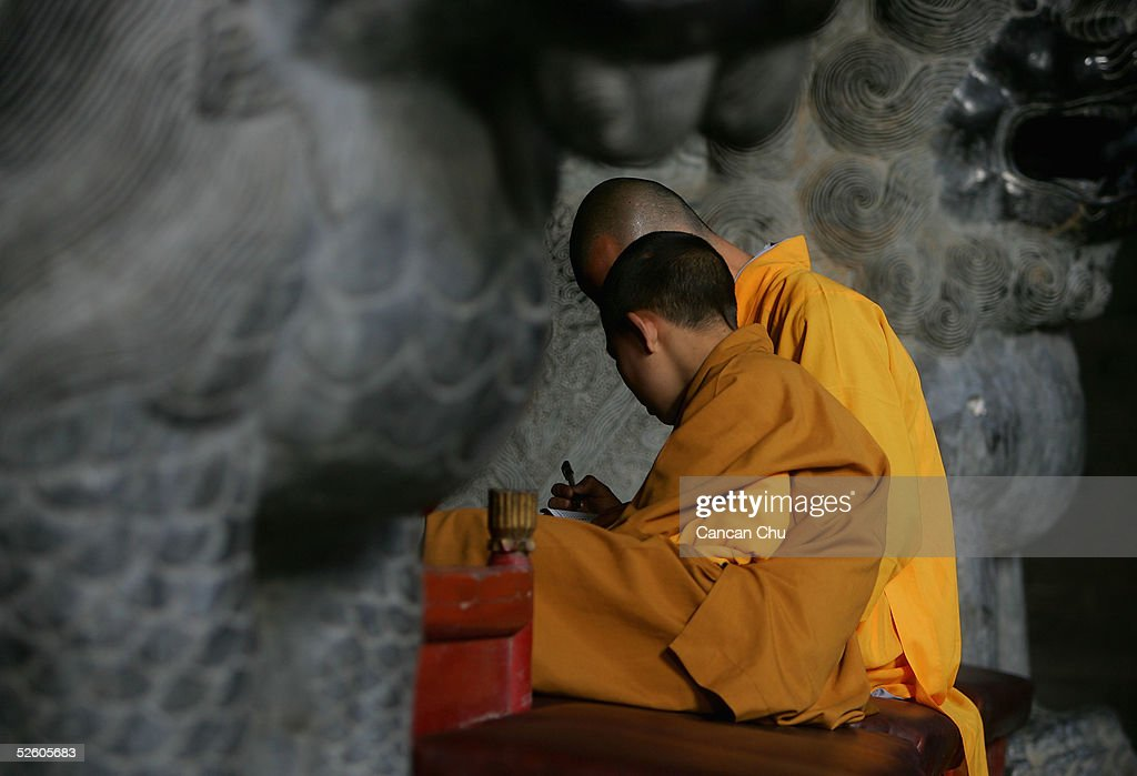 Warrior monks of Shaolin Temple discuss the passages from