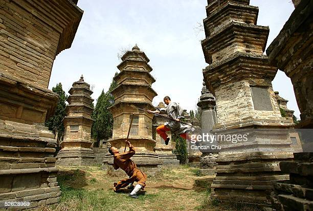 Warrior monks of Shaolin Temple display their Kung Fu skills at the Pagoda Forest of the temple April 12 2005 in Dengfeng Henan Province China...