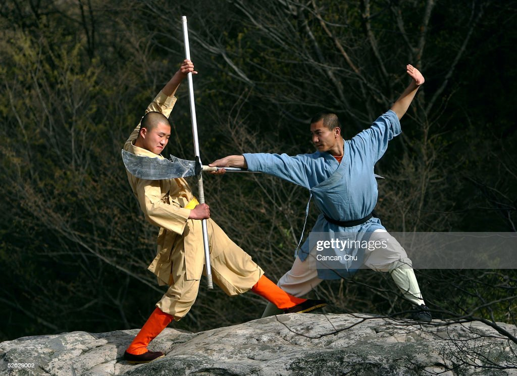 Warrior monks of the Shaolin Temple display their Kung Fu skills at the Songshan Mountain near the temple April 12, 2005 in Dengfeng, Henan Province, China. Shaolin Temple, built in AD 495 in the period of the Northern and Southern Dynasties (420-581) and located in the Songshan Mountain area, is the birthplace of Shaolin Kung Fu. Shaolin Kung Fu, with its incredible strength, vitality and flexibility, is expecting to be included in the UNESCO intangible heritage list.