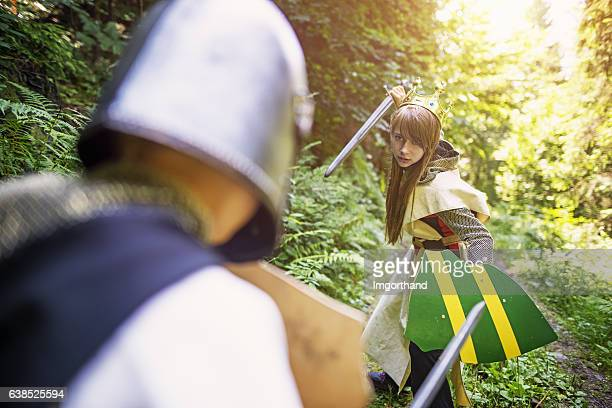 warrior princess fighting with a knight - girl fight stock photos and pictures