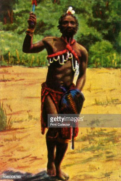 Warrior South Africa circa 1928 African man in traditional costume From Die Welt in Bildern cigarette card album circa 1928 [Georg A Jasmatzi AG...