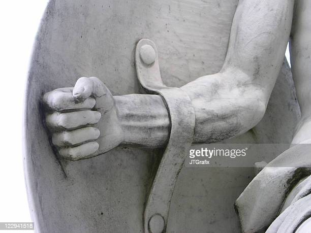 warrior strong arm and shield statue detail - shield stock pictures, royalty-free photos & images