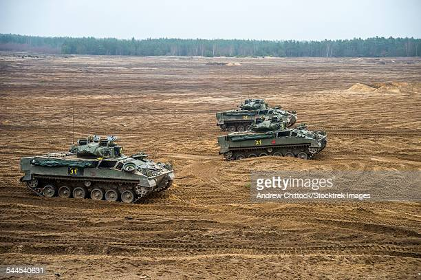 warrior tracked infantry fighting vehicles of the british armed forces during exercise black eagle in poland. - british military stock pictures, royalty-free photos & images