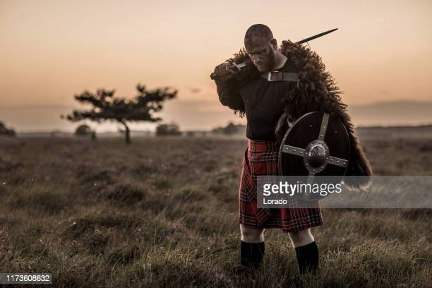 warrior wearing a kilt - golf tournament stock pictures, royalty-free photos & images