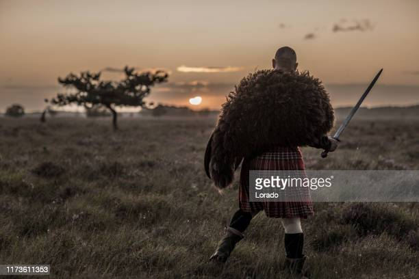 warrior wearing a kilt - scotland stock pictures, royalty-free photos & images