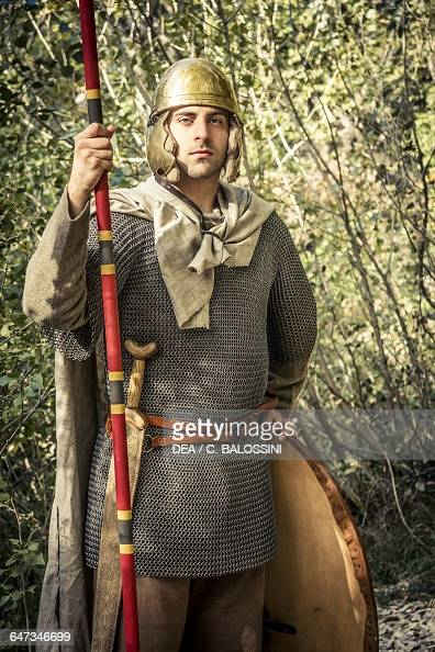 Warrior with chain mail, helmet, sword, spear and shield,    News