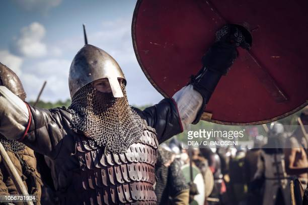 Warrior with helmet, scale armour and shield rejoicing after victory in battle, Festival of Slavs and Vikings, Centre of Slavs and Vikings,...