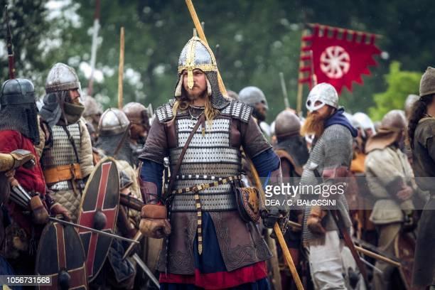 Warrior with lamellar armour helmet and pike Festival of Slavs and Vikings Centre of Slavs and Vikings JomsborgVineta Wolin island Poland Slavic and...