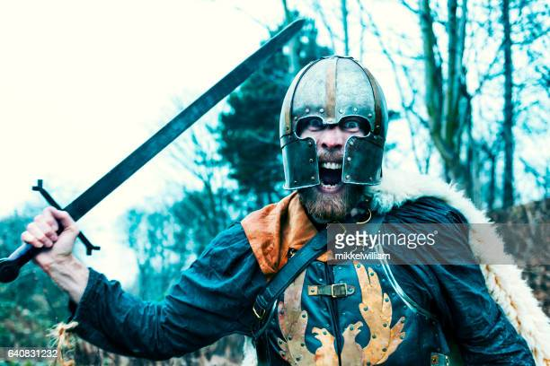 warrior with sword attacks and screams - warrior person stock photos and pictures