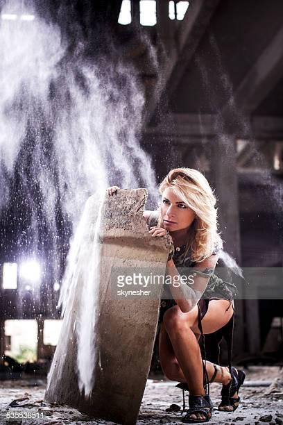 Warrior woman hiding in ruins.