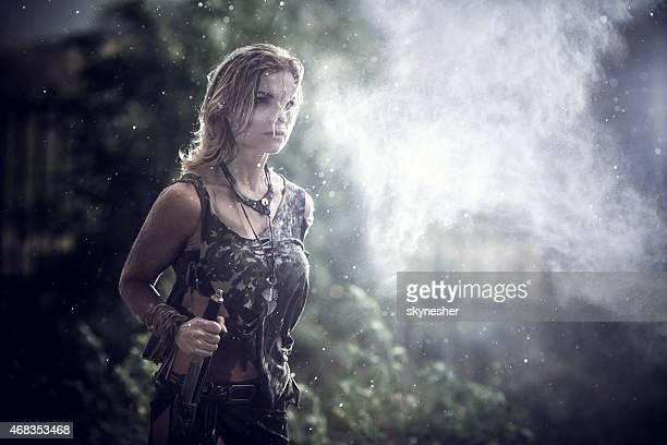 Warrior woman walking in the rain.