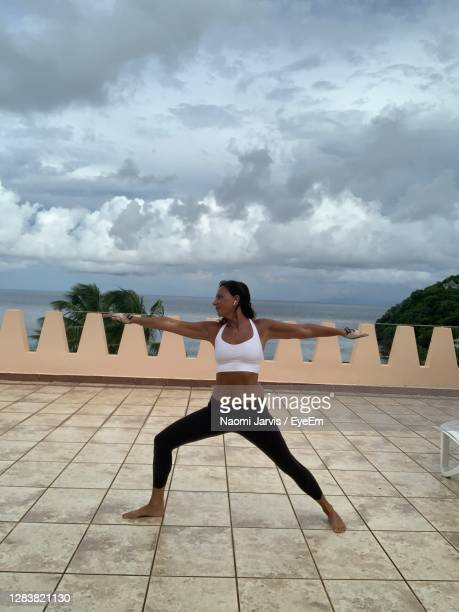 warrior yoga pose - naomi jarvis stock pictures, royalty-free photos & images