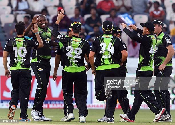 Warriors bowler Lonwabo Tsotsobe celebrates with teammates as he dismissed Redbacks batsman Daniel Harris during the Champions League Twenty20 Group...