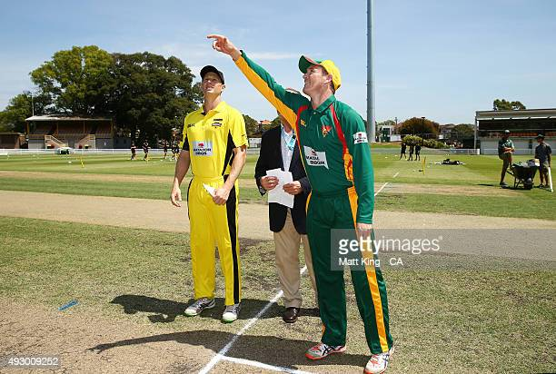 Warriors captain Adam Voges and Tigers captain George Bailey take part in the coin toss during the Matador BBQs One Day Cup match between Tasmania...