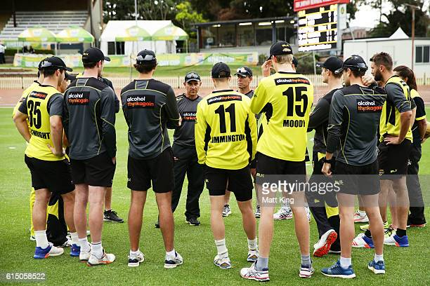 Warriors coach Justin Langer speaks to his players prior to the Matador BBQs One Day Cup match between the Cricket Australia XI and Western Australia...