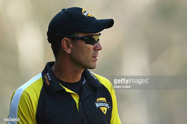 Warriors coach Justin Langer watches on during the Ryobi Cup match between the Tasmania Tigers and the Western Australia Warriors at Blacktown...
