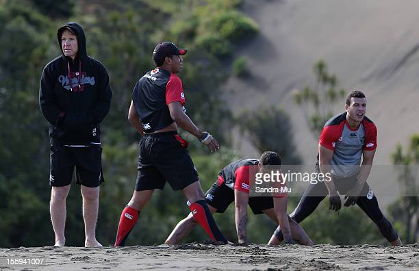 Warriors Coach Matthew Elliott watches the players train on the sand dunes during the New Zealand Warriors NRL training session at Bethells Beach on...