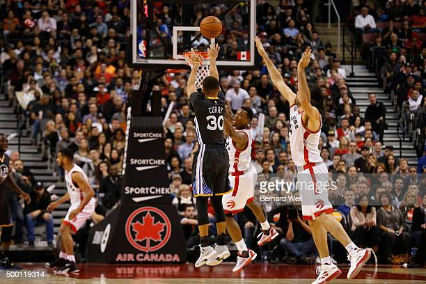 Warriors' guard Stephen Curry makes a shot in 2nd half action Curry scored 44 points in the game Toronto Raptors vs Golden State Warriors in NBA...