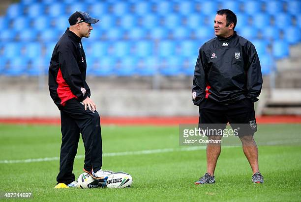 Warriors head coach Andrew McFadden and Junior Warriors coach Stacey Jones in conversation during a New Zealand Warriors NRL training session at Mt...