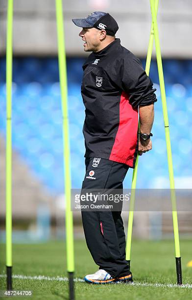 Warriors head coach Andrew McFadden delivers instructions to his players during a New Zealand Warriors NRL training session at Mt Smart Stadium on...