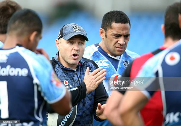 Warriors head coach Andrew McFadden discusses tactics during a New Zealand Warriors NRL training session at Mt Smart Stadium on April 22, 2014 in...