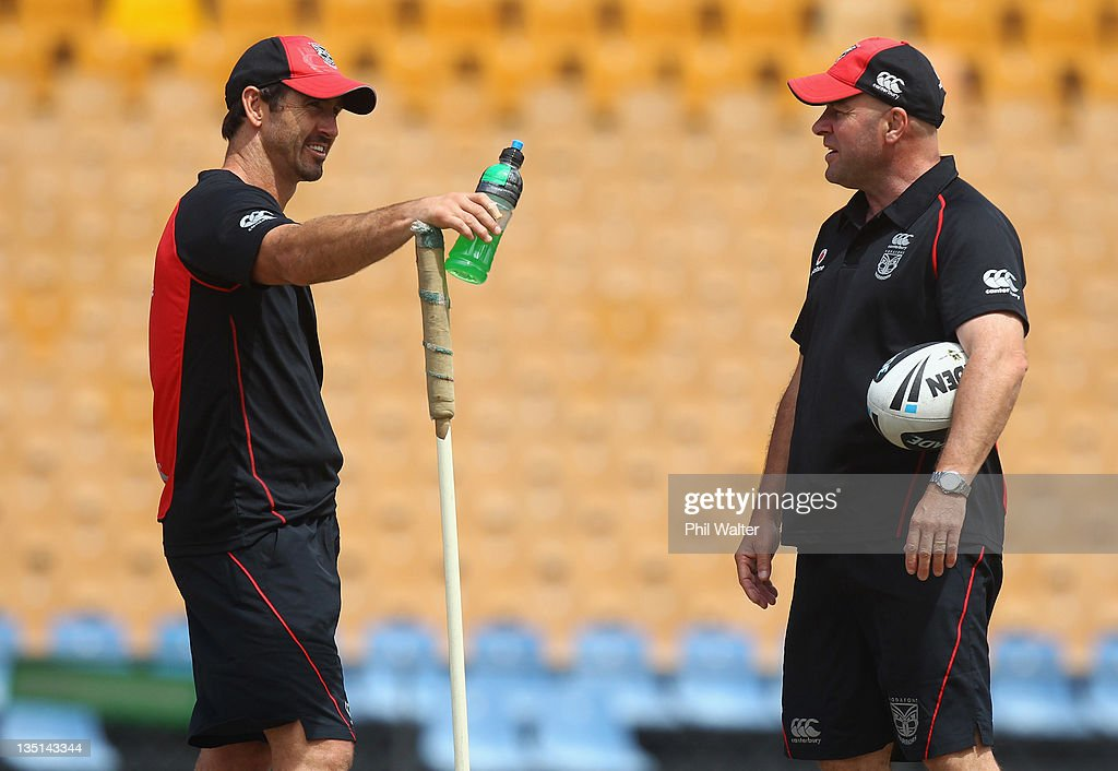 Warriors Head Coach Brian McClennan (R) talks with skills coach Andrew Johns during a New Zealand Warriors media session at Mt Smart Stadium on December 7, 2011 in Auckland, New Zealand.
