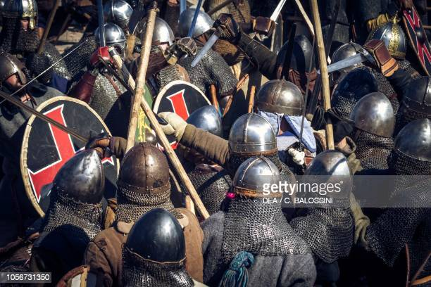 Warriors in battle with pikes shields and swords Festival of Slavs and Vikings Centre of Slavs and Vikings JomsborgVineta Wolin island Poland Slavic...