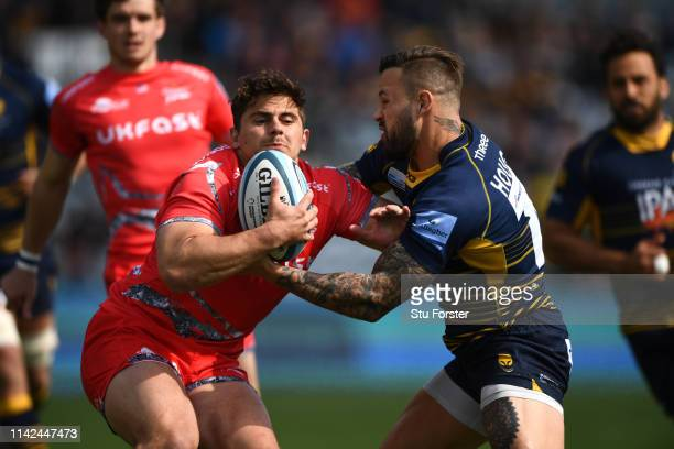 Warriors player Francois Hougaard gets to grips with Rohan Janse van Rensburg of Sale during the Gallagher Premiership Rugby match between Worcester...
