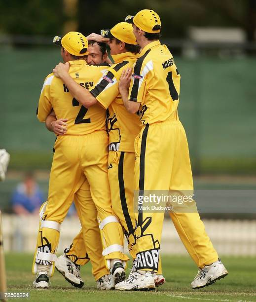 Warriors players celebrate their win in the ING Cup match between the Victorian Bushrangers and the West Australian Warriors at the Junction Oval on...