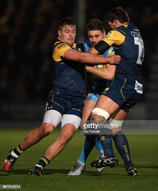 Warriors players Nick Schonert and Donncha O' Callaghan combine to stop Irish centre Tom Fowlie during the Aviva Premiership match between Worcester...