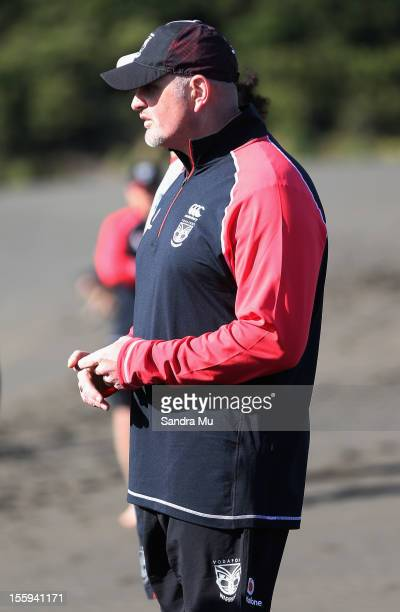 Warriors sports science manager Brad Morris watches players train on the sand dunes during the New Zealand Warriors NRL training session at Bethells...