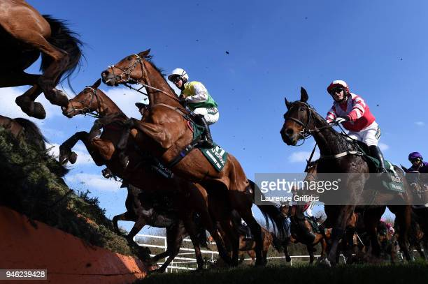 Warriors Tale ridden by Sean Bowen jumps Canal Turn during the 2018 Randox Health Grand National at Aintree Racecourse on April 14 2018 in Liverpool...