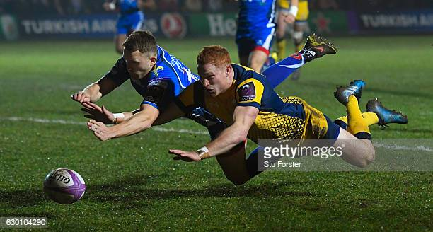 Warriors wing Connor Braid dives to beat Tom Prydie to score the opening try during the European Rugby Challenge Cup match between Newport Gwent...