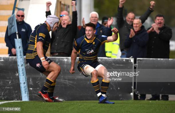Warriors wing Josh Adams celebrates with Gareth Milasinovich after scoring his third try during the Gallagher Premiership Rugby match between...