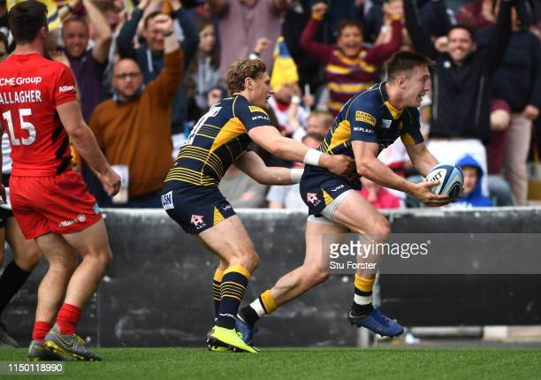 Warriors wing Josh Adams celebrates with Tom Howe after scoring his try during the Gallagher Premiership Rugby match between Worcester Warriors and...