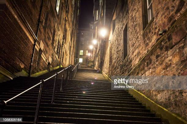 warriston's close steep staircase at night with bright street lights, old town, edinburgh - sandstone wall stock pictures, royalty-free photos & images