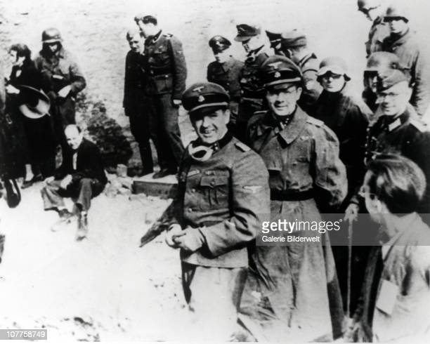 Warsaw Ghetto Uprising German SS general Juergen Stroop with his staff during the ghetto revolt 8th May 1943 Left A Jewish couple captured in a...