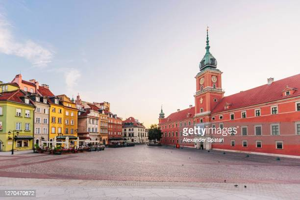 warsaw old town and town hall at sunrise, warsaw, poland - warsaw stock pictures, royalty-free photos & images
