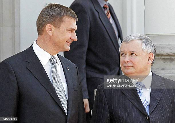 Estonian Prime Minister Andrus Ansip and his Polish counterpart Jaroslaw Kaczynski look at each other during a welcoming ceremony in Belweder palace...
