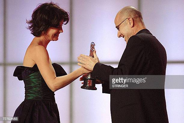 German actor Ulrich Muehe receives the award from Frenchborn Swiss actress Irene Jacob he received as Best European Actor 2006 at the awards ceremony...