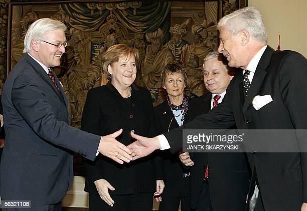 German Chancellor Angela Merkel and Polish Presidentelect Lech Kaczynski look on as Foreign Ministers FrankWalter Steinmeier and Sefan Meller...