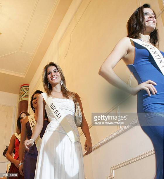 Maria Beatriz Vallejos Schulze of Argentina and Ana Maria Ortiz Rodal of Bolivia walk on stage during a ceremony at the Chinese Embassy in Warsaw 26...