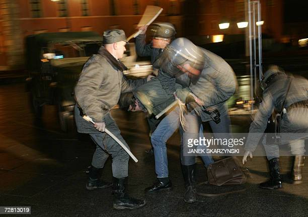 Polish activists of Citizen Responsibility disguised as members of the loathed communistera riot squad show a mock street fight in an Old Town in...