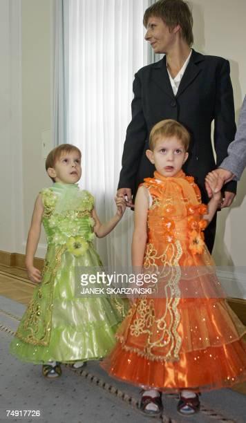 Polish conjoined twins Olga and Daria Kolacz come with their mother Wieslawa Dabrowska for a meeting with King of Saudi Arabia Abdullah bin Abdulaziz...