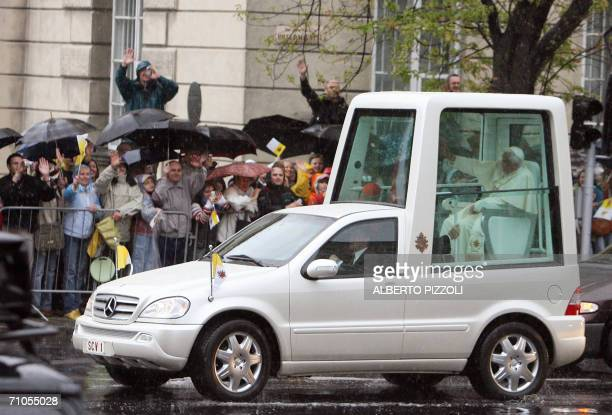 Pope Benedict XVI arrives escorted by Polish police under heavy rain on his popemobile at Warsaw's Pilsudski Square to celebrate a Holy Mass, 26 May...