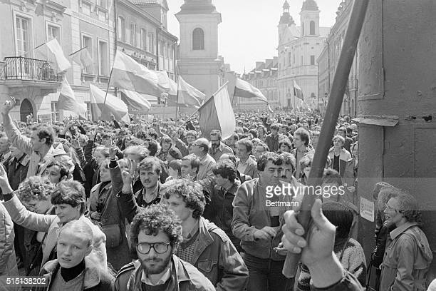 Waving flags flashing the victory sign and lustily chanting Love live Solidarity scores of thousands of Poles defiantly staged a May Day show of...