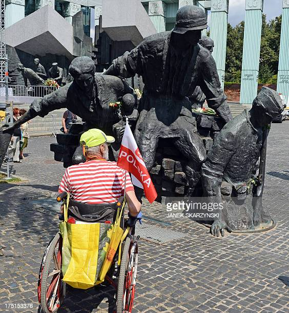 A Warsaw resident looks a monument to the Poles who fought Nazi German occupation troops in 1944 during a ceremony on August 1 2013 marking the...