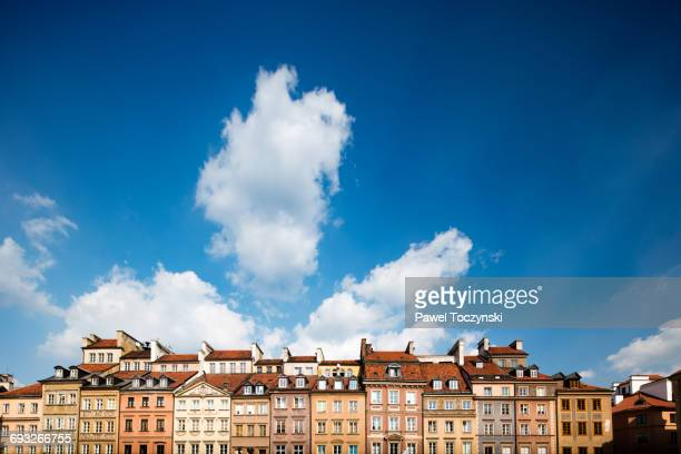 warsaw's old town against a simmer sky - warsaw stock pictures, royalty-free photos & images